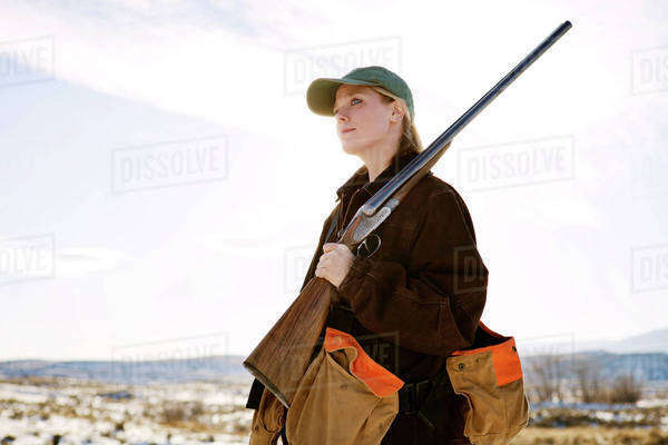 Female hunter in snowy field Royalty-free stock photo