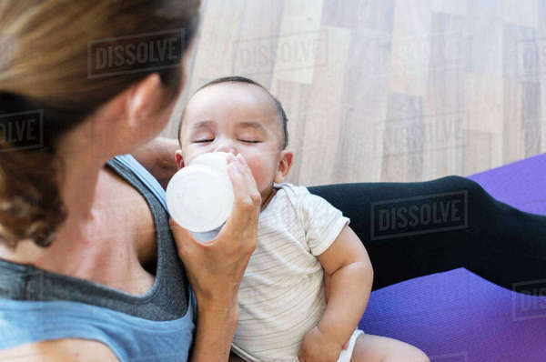 High angle view of mother feeding son while sitting at home Royalty-free stock photo