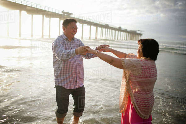 Couple dancing on shore at beach Royalty-free stock photo