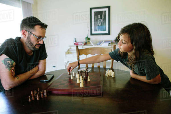Father and daughter playing chess at home Royalty-free stock photo