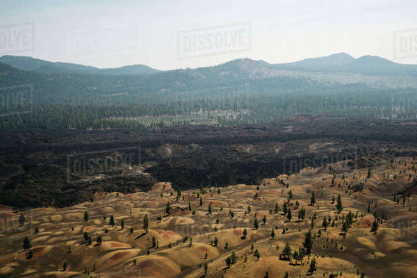 Scenic view of volcanic landscape against sky during sunny day Royalty-free stock photo