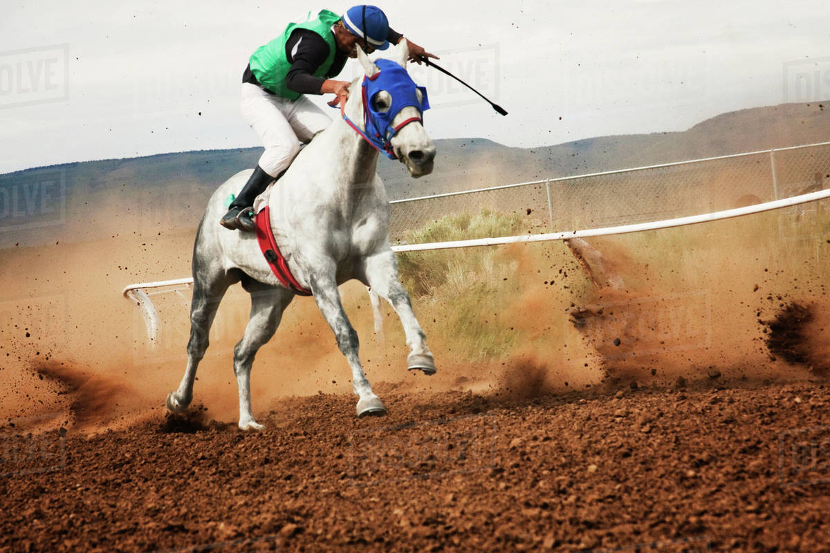 Teenager 16 17 Horse Racing On Dirt Track Stock Photo Dissolve