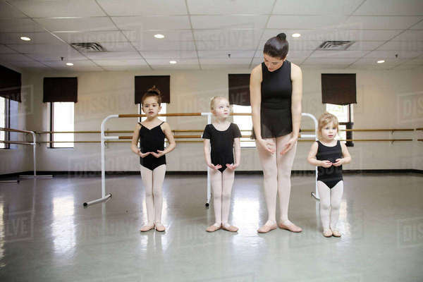 Ballerina teaching students in dance studio Royalty-free stock photo
