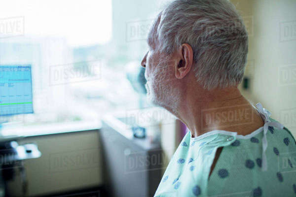 Close-up of patient looking away while relaxing in hospital ward Royalty-free stock photo