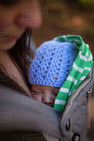 Close-up of mother with son sleeping in baby carrier Royalty-free stock photo