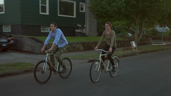 Handheld shot of friends cycling on road in city Royalty-free stock video