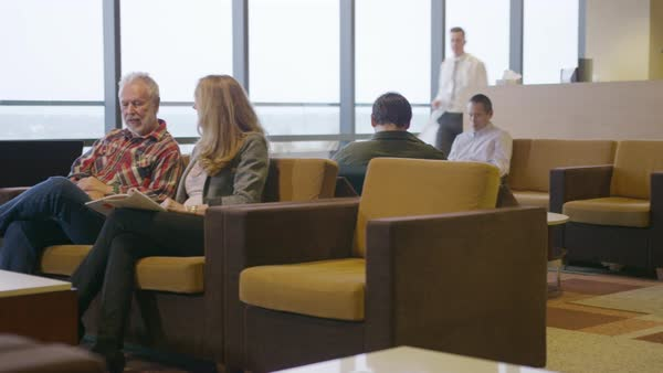 Handheld shot of patients sitting in waiting room at hospital Royalty-free stock video