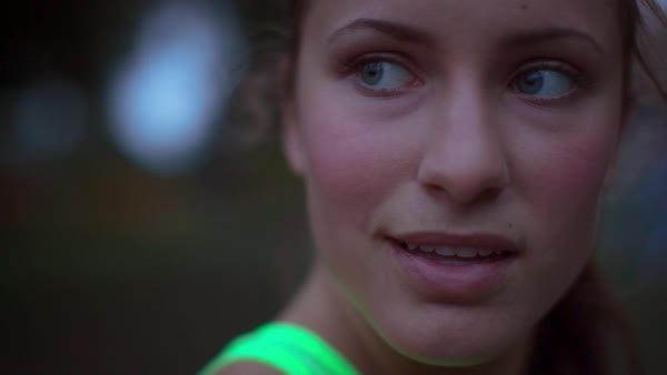 Handheld close-up of tired female athlete looking away while taking breath Royalty-free stock video