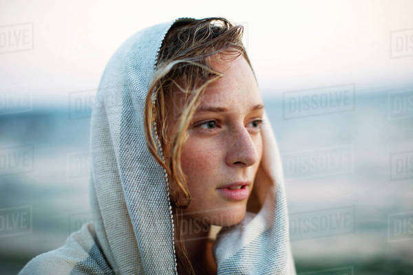 Portrait of young woman wrapped in blanket Royalty-free stock photo