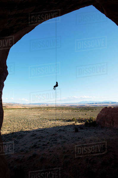 Man on mountain climbing rope Royalty-free stock photo