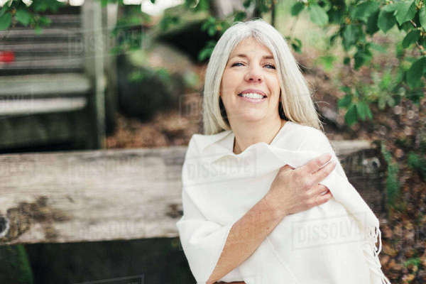 Portrait of smiling mature woman standing at park Royalty-free stock photo