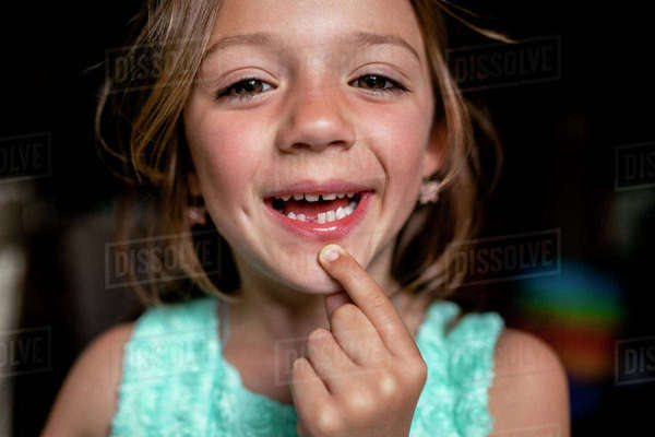 Portrait of girl showing gap tooth Royalty-free stock photo