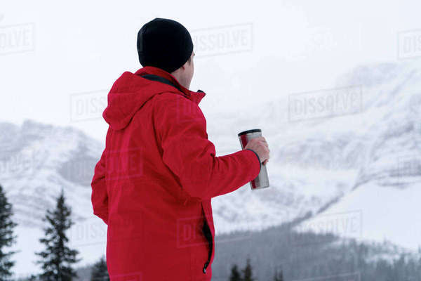 Side view of hiker having drink during foggy weather Royalty-free stock photo