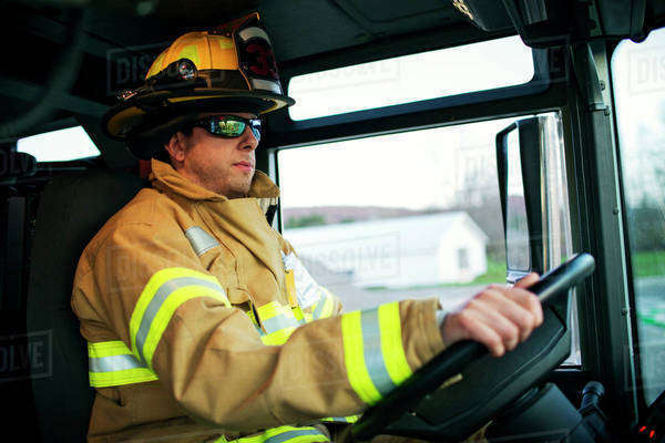 Firefighter driving fire truck Royalty-free stock photo