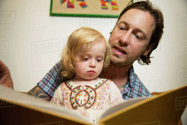 Father reading book with little daughter (18-23 months) Royalty-free stock photo