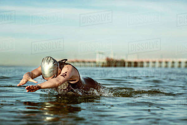 Female athlete swimming in sea Royalty-free stock photo