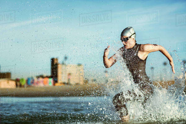 Woman running in sea Royalty-free stock photo