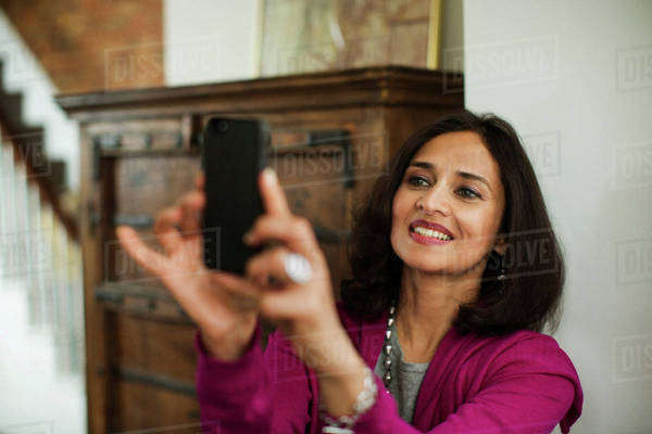 Woman taking selfie at home Royalty-free stock photo
