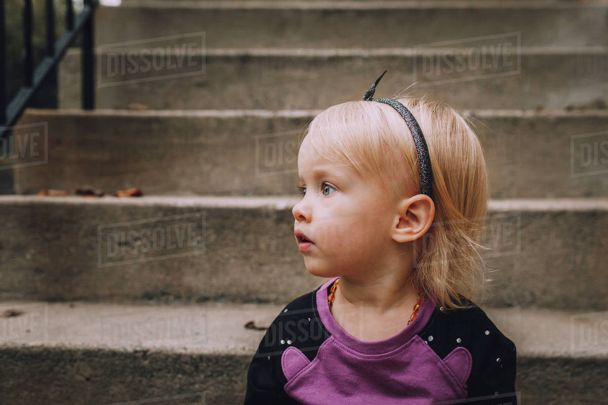 cute baby girl looking away against steps - stock photo - dissolve
