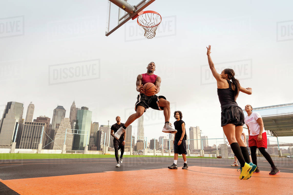 Young people playing basketball Royalty-free stock photo