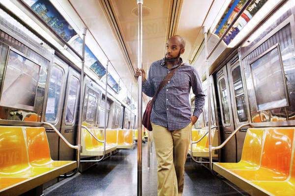 Young man standing in empty subway car Royalty-free stock photo