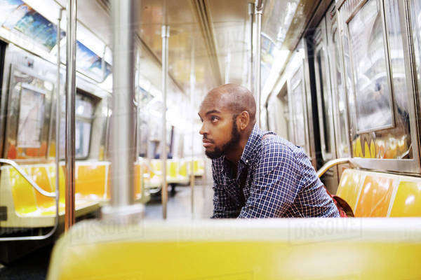 Young man sitting in empty subway car Royalty-free stock photo