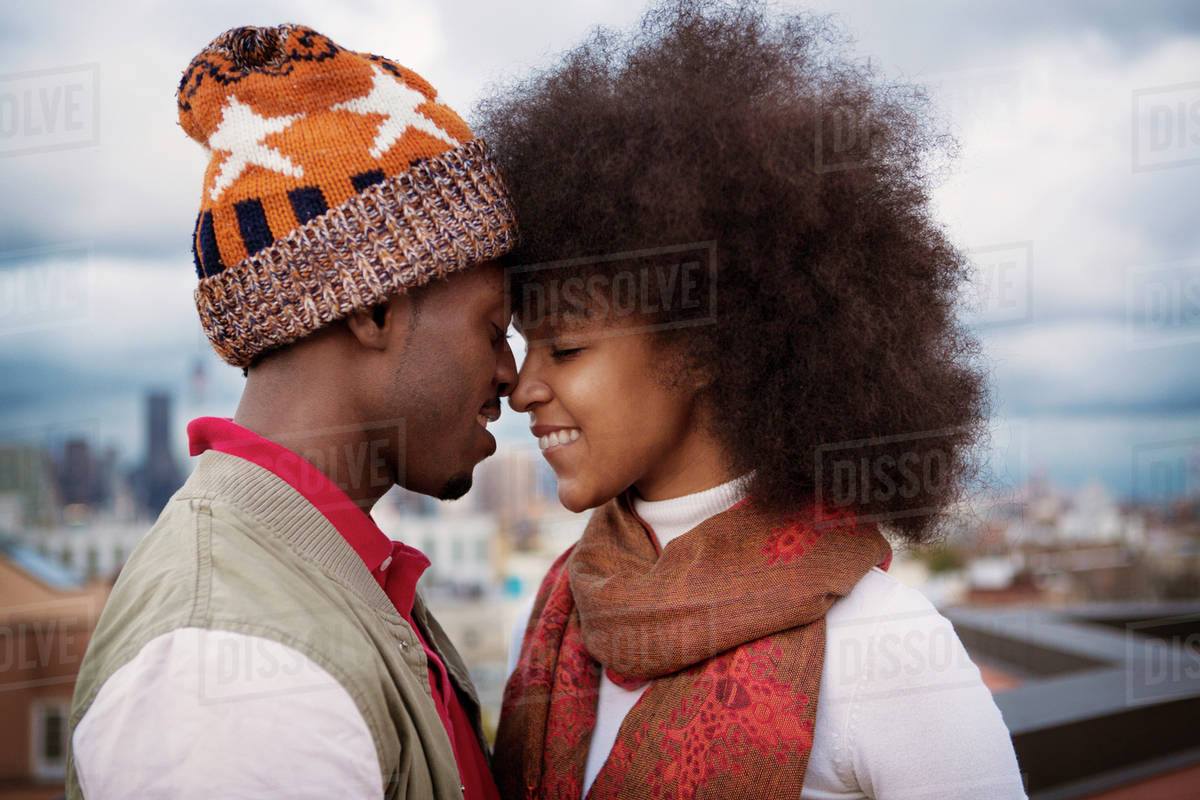 Couple rubbing noses on roof Royalty-free stock photo