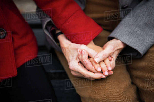 Grandmother with granddaughter (8-9) holding hands in park Royalty-free stock photo