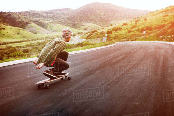 Man longboarding down the road Royalty-free stock photo