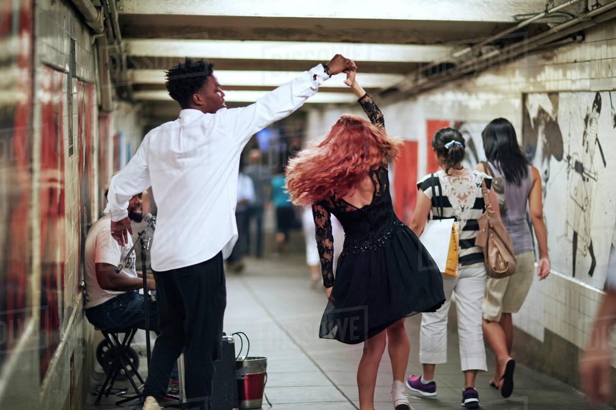 Couple dancing in subway corridor Royalty-free stock photo