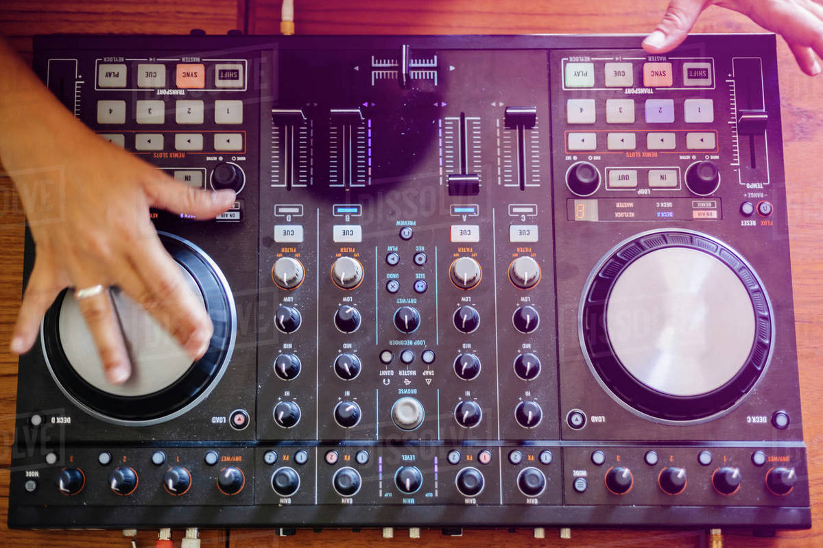 Cropped hands of female DJ mixing sound on table in recording studio stock  photo