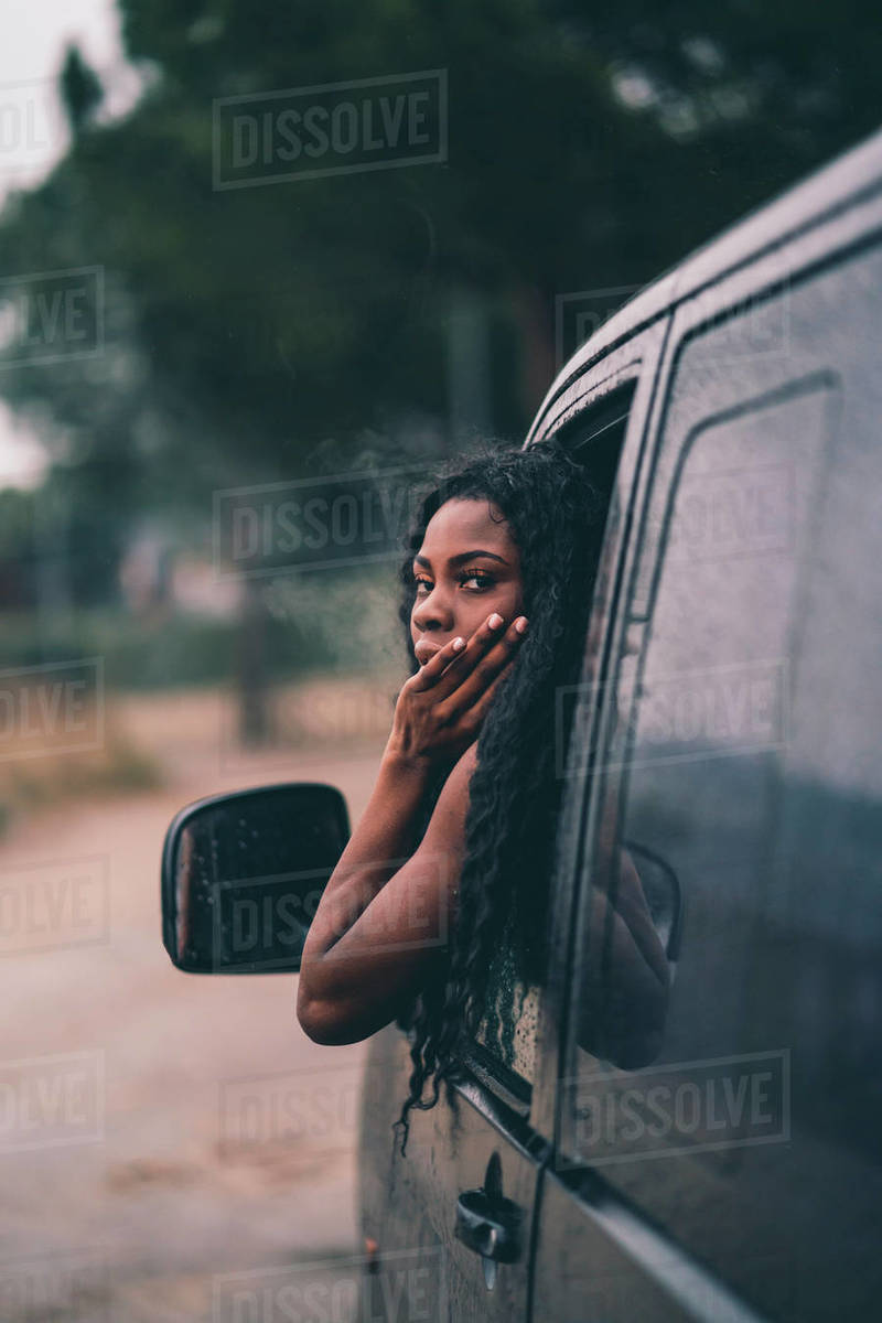 Nice african woman in car window. Royalty-free stock photo