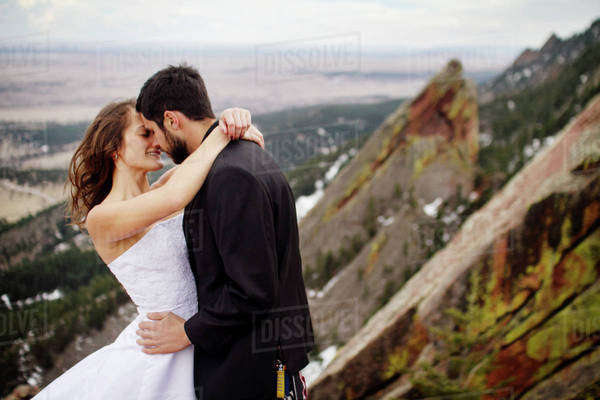 Couple kissing on top of mountain Royalty-free stock photo