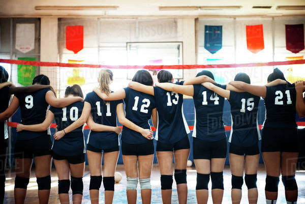 Team of volleyball players in sports hall Royalty-free stock photo