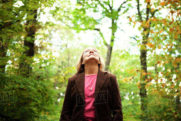 Mature woman looking up in park Royalty-free stock photo