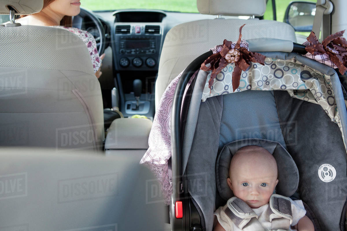 High Angle Portrait Of Toddler Sitting In Car Seat