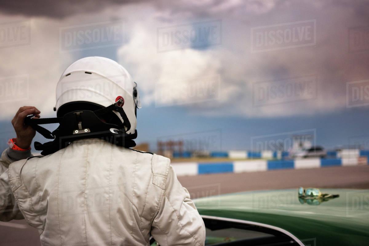 Race Car Driver Putting Helmet On Stock Photo Dissolve