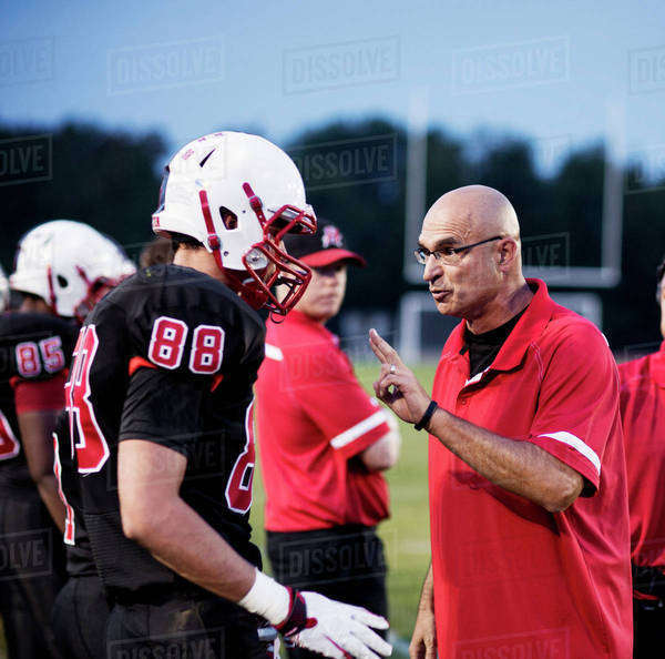 Coach talking with football players (16-17) Royalty-free stock photo