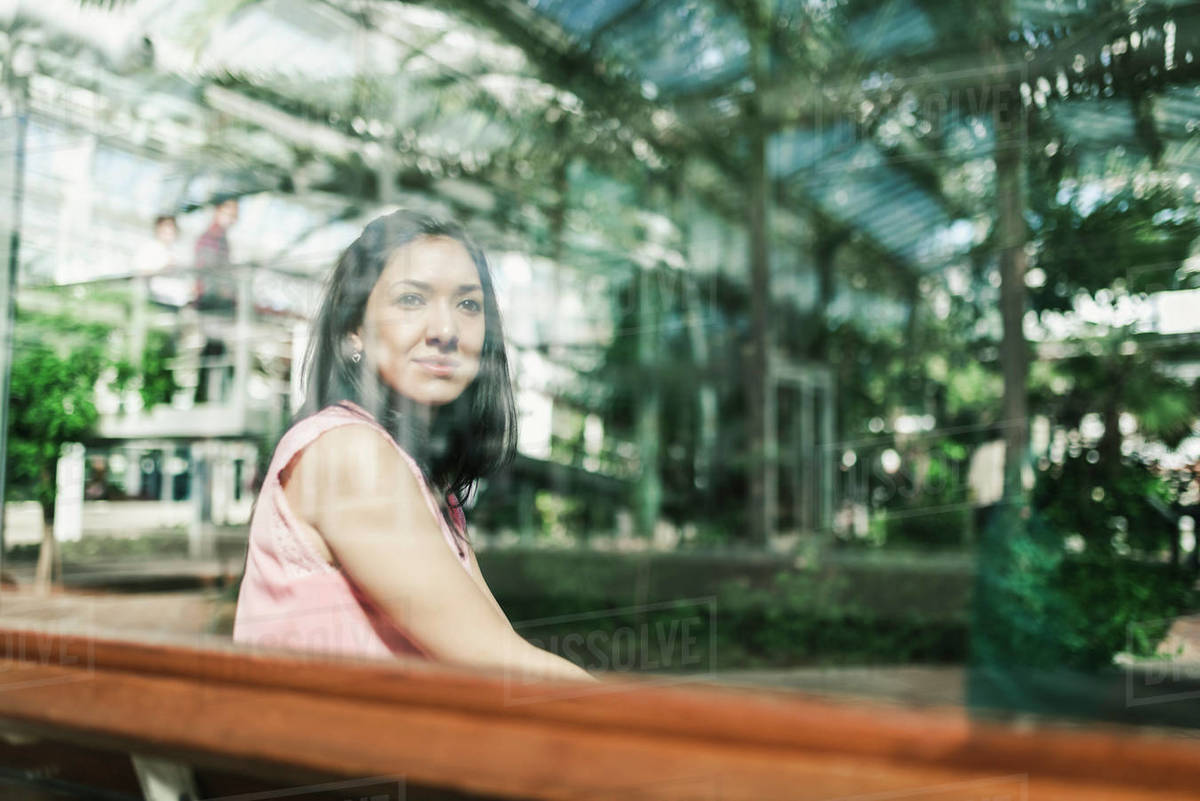 Beautiful agronomical engineer sitting in the greenhouse Royalty-free stock photo
