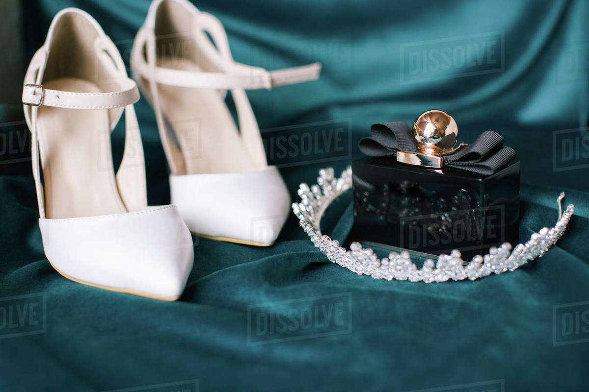 Bridal accessories. Bridal shoes, perfume and crown. Royalty-free stock photo