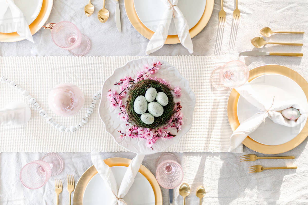 Overhead shot of easter tablescape with cherry blossoms Royalty-free stock photo