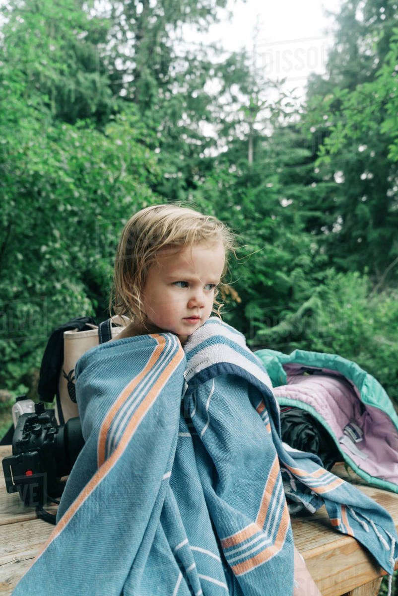 A portrait of a young girl in a towel after swimming in Oregon. Royalty-free stock photo