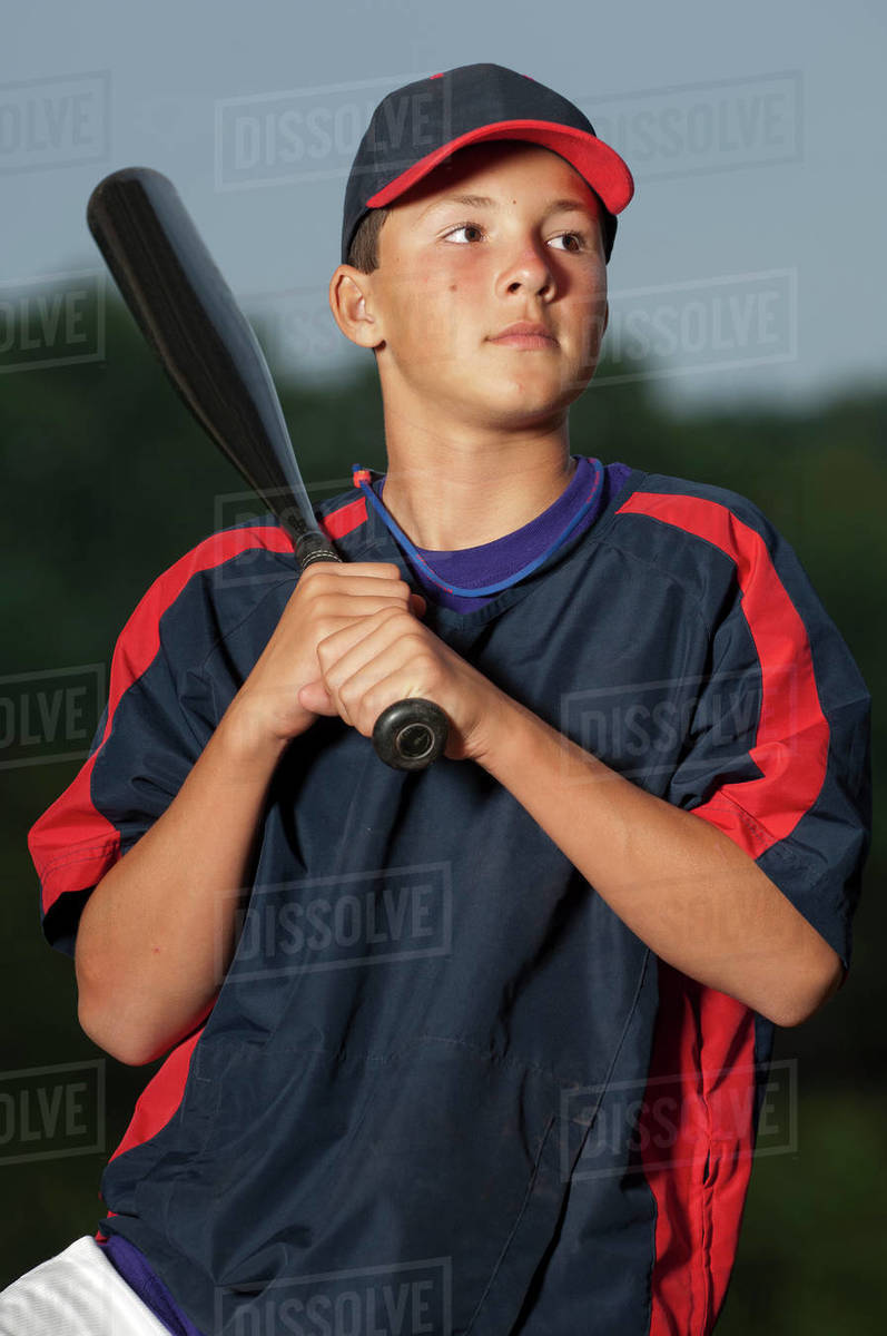 Portrait of a baseball player holding his bat wearing a warm up jacket Royalty-free stock photo
