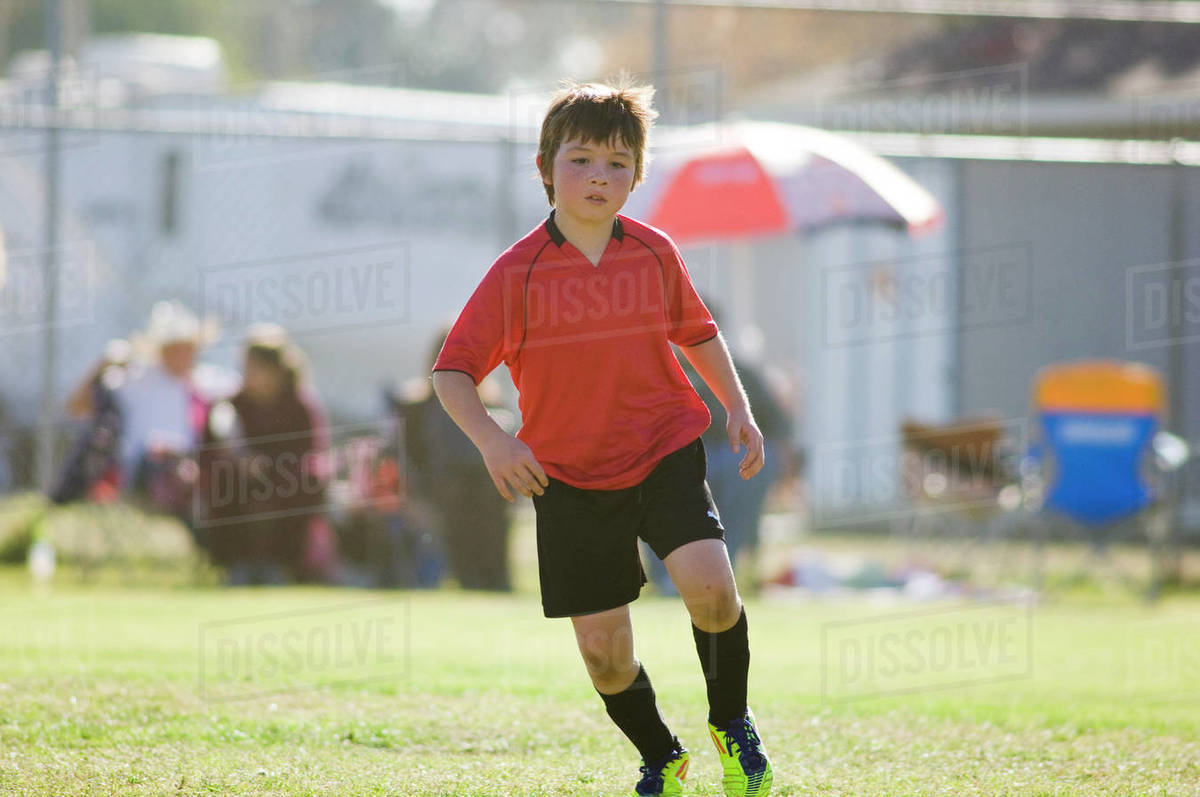 Young boy concentrating on a soccer field Royalty-free stock photo