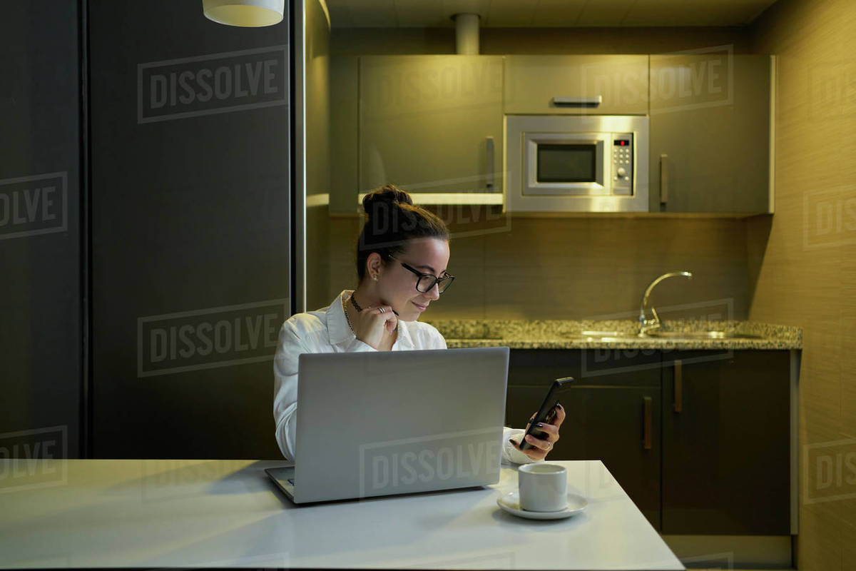 Young woman working with laptop in evening Royalty-free stock photo