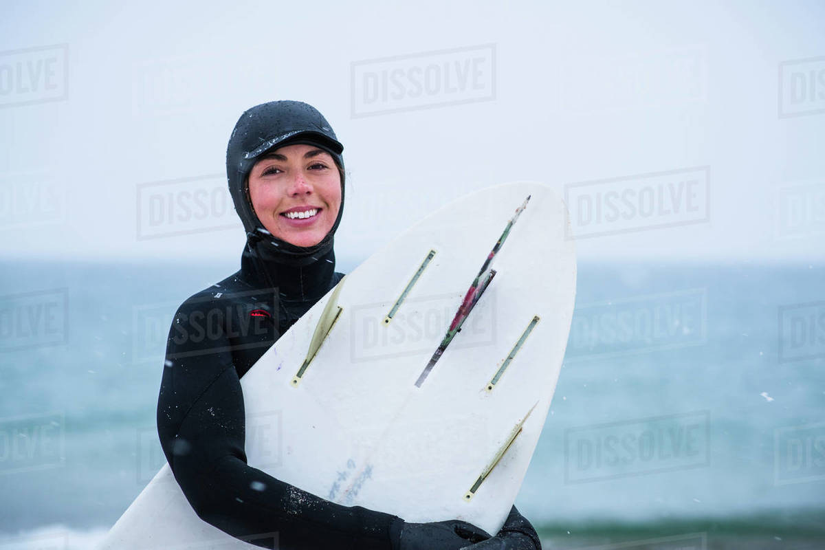 Young woman going winter surfing in snow Royalty-free stock photo