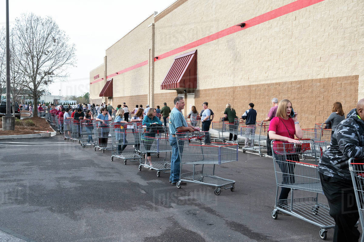 Shoppers waiting in line to get into a Costco store at the opening. Alabama. Royalty-free stock photo