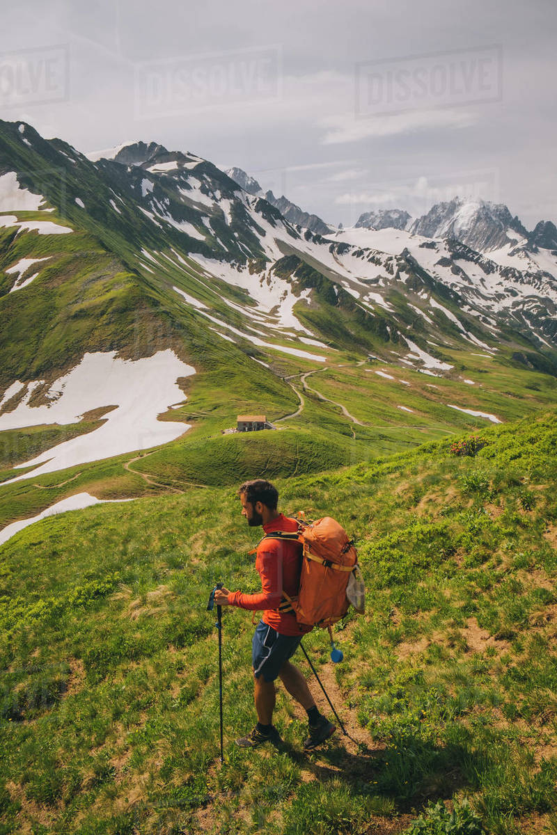 Young male hiking in the French alps between France and Switzerland Royalty-free stock photo