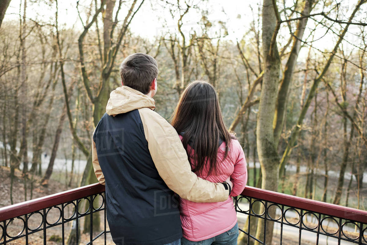 Young loving couple enjoy the sun and warm stroll in the spring park Royalty-free stock photo
