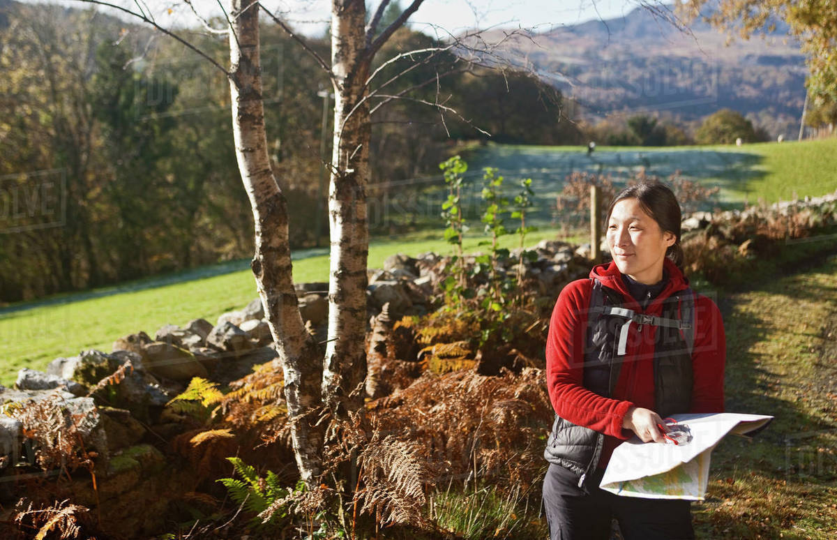 Mature female hiker reading map Royalty-free stock photo